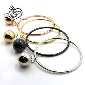 Stainless steel hanging light hollow ball funky bangle