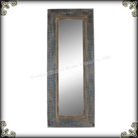 Distressed vintage ornate natural wooden framed mirror