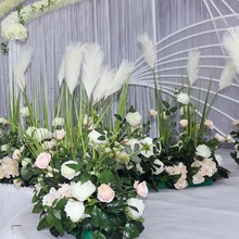 Latest weddings decoration artificial flower rose and reed ground arrange flower stage decorations