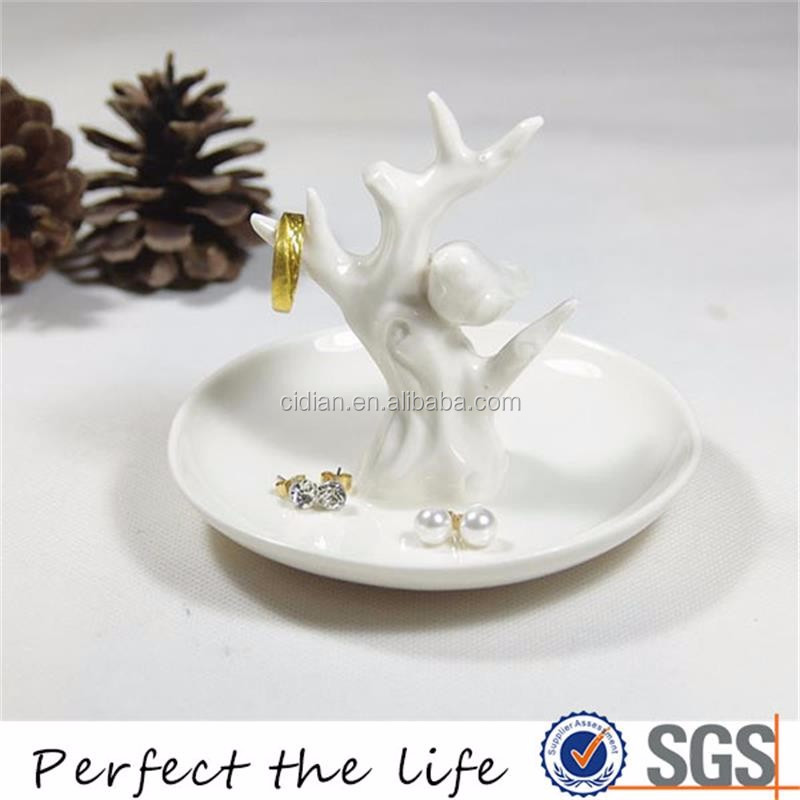 White ceramic ring jewelry holder with tree round plate
