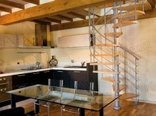 Artistical save space with wood step spiral staircase