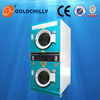 Commercial laundry stack washer dryer with coin receiver