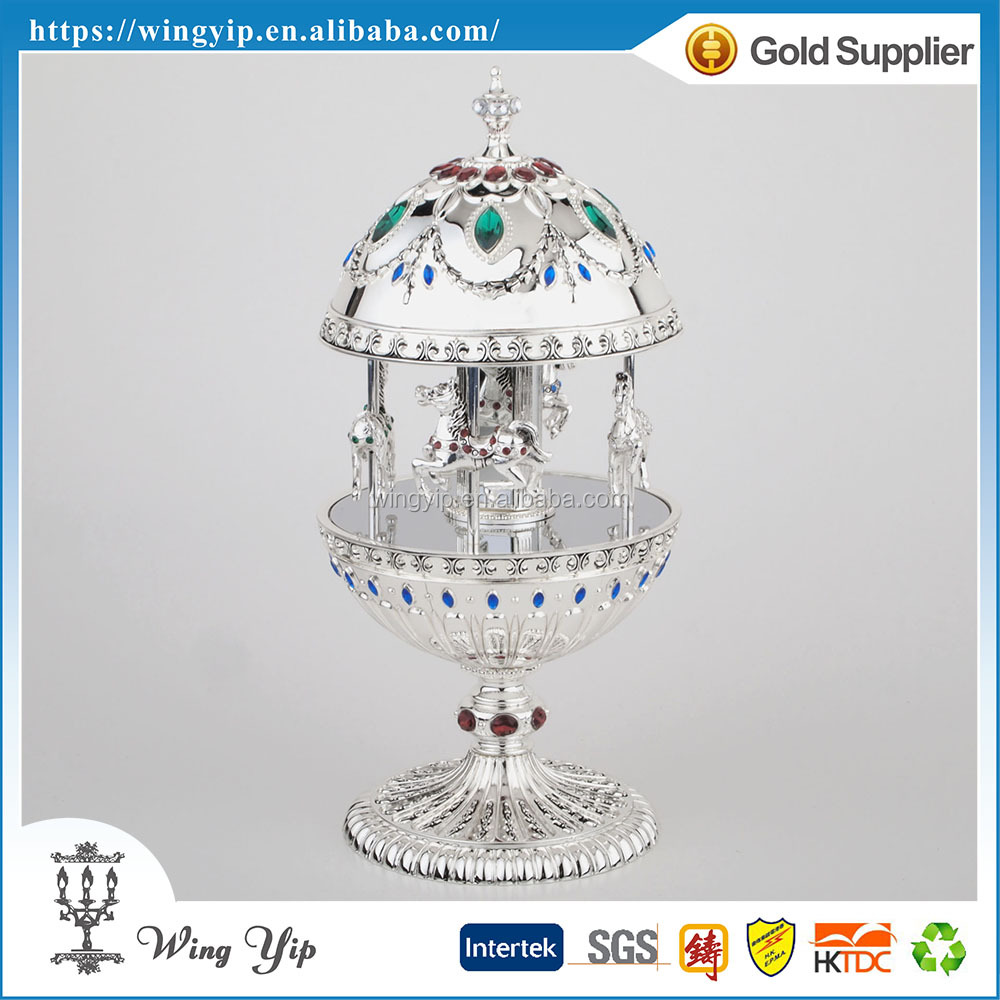 Custom made hot sales Egg Shape with Carousal horse Metal Hand crank Music box for decoration