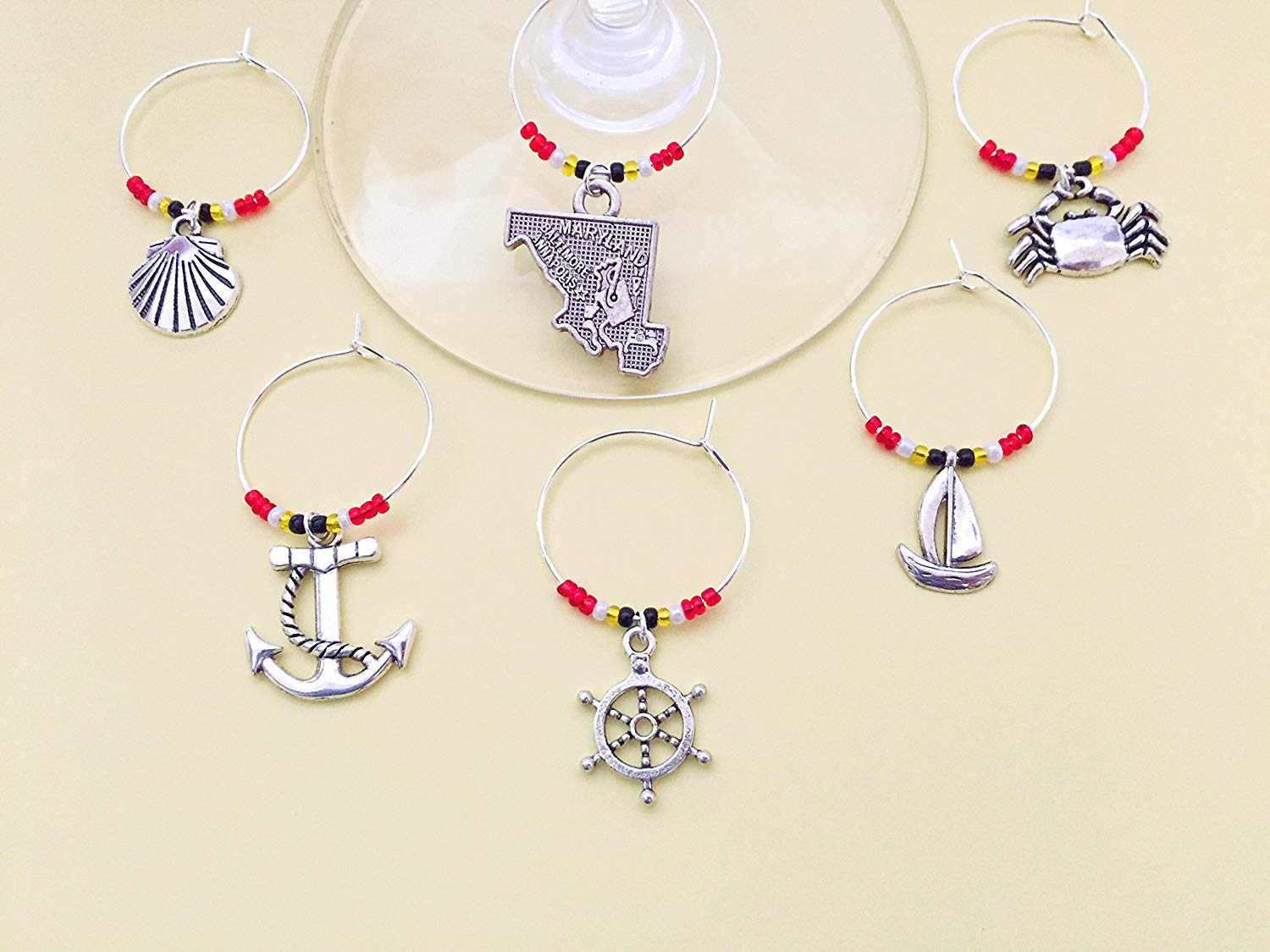 Maryland Nautical Themed Wine Charms, Ships Ahoy, Sailing gift. Includes Maryland state, Crab, Anchor, Ship Wheel, Lighthouse, Sailboat etc. Beach lover gift. Set of 8. MARYLAND FLAG THEMED BEADS.