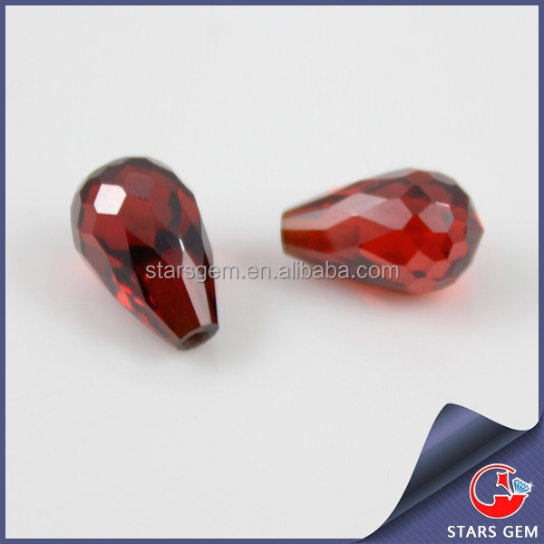 Loose water droplets shape red garnet cubic zirconia