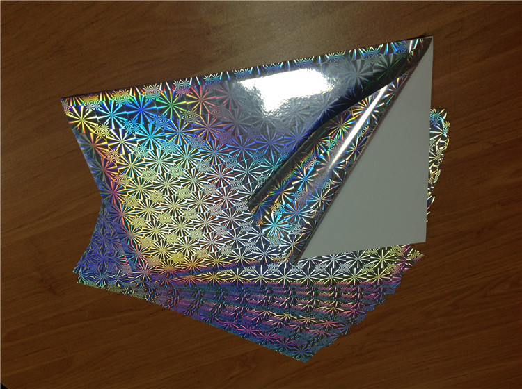 High quality holographic pattern self adhesive paper sticker packed in roll