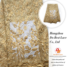 Factory free sample latest design french gold beaded tulle lace fabric for lady