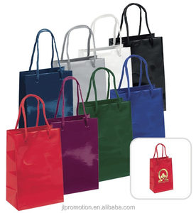 Paris Euro Bag are 128 GSM gloss paper shoppers designed with reinforced fold over tops and macrame handles