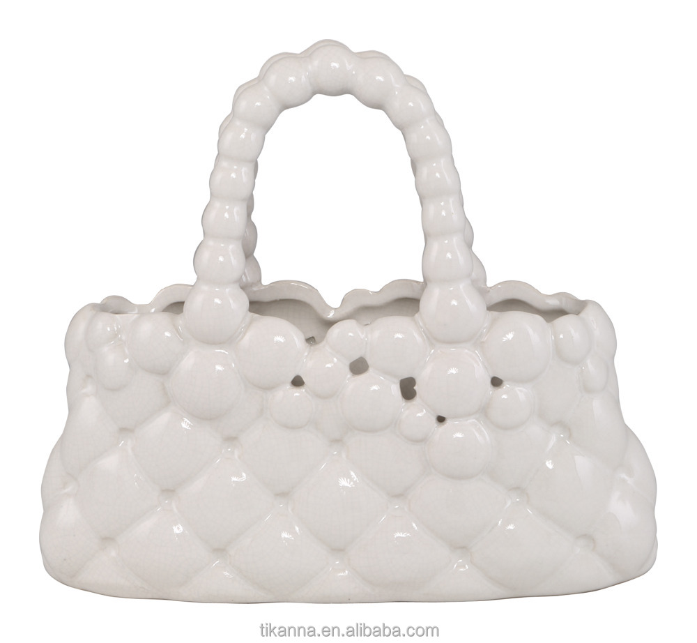white bag shaped ceramic indoor ornament