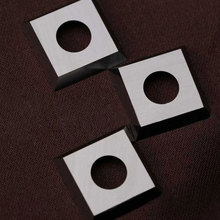 Tungsten carbide cutter insert for wood cutting