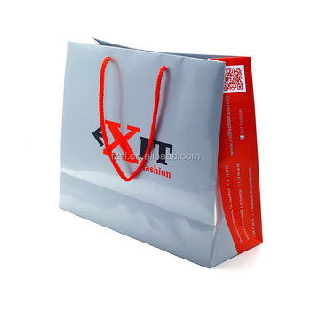 China factory custom luxury laminated art paper gift bag with pp rope handle