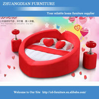 red fabric hearted shape marriage bed