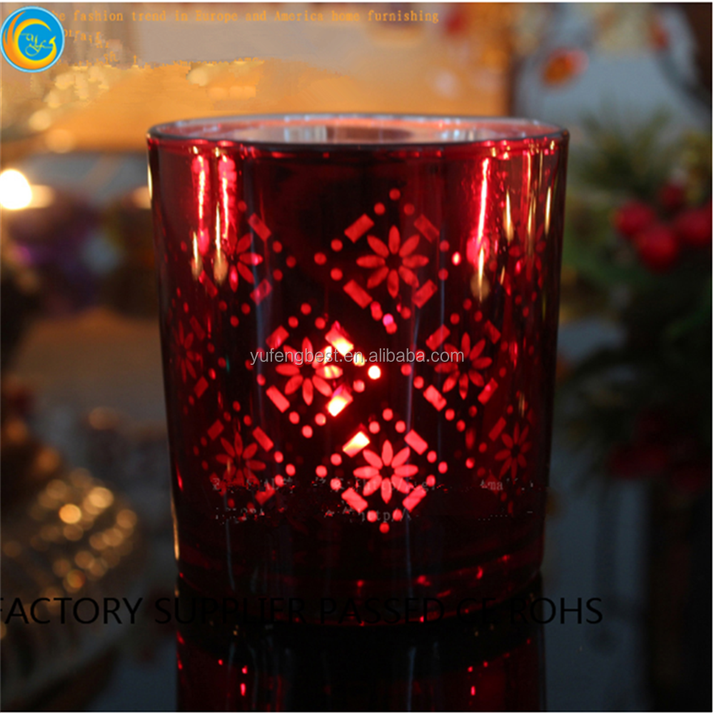 red glass jars with floating candles