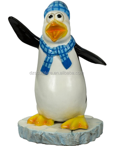 Design lovely fiberglass penguin statue with wearing hat and scarf