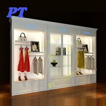 e03e44151a Ladies antique clothing wall display cabinet clothes shop design store  interior design