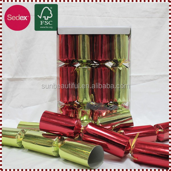 Red and yellow christmas crackers with many gifts inside
