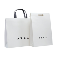 Qingdao supplies Wholesale Customized white shopping paper bag with logo UV for packaging