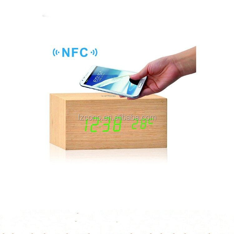 Creative modern high-tech Sound controlled NFC Wooden LED Digital Alarm Clock with wireless mobile phone charger