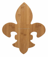 custom bamboo fleur de lis shaped cutting & serving board with hole for hanging, a great gift for any Francophile