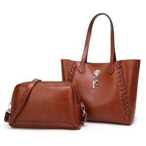 Online wholesale 2018 handmade weaving hand bags set , PU leather women handbag