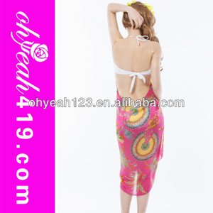 Women wear bright red long beach sari magic wrap skirt