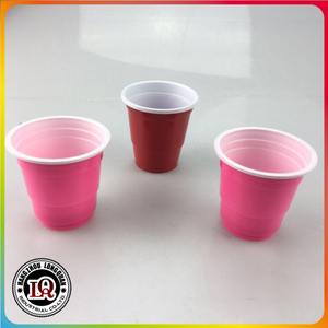 Disposable 2oz red and pink solo beer pong plastic cups
