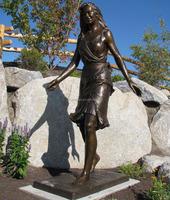 modern western casting bronze walking female sculpture