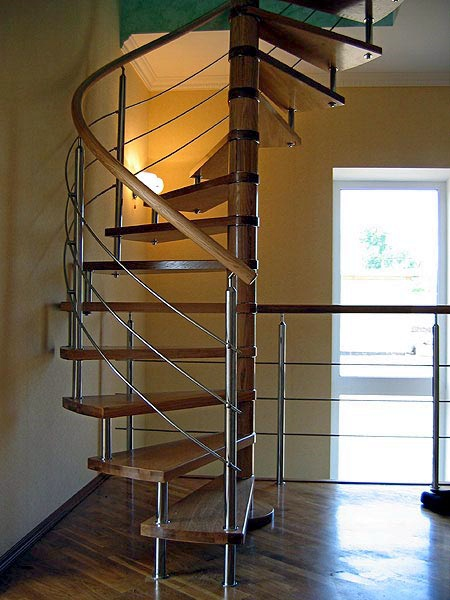 cast iron wood helical stair or spiral staircase with metal railing