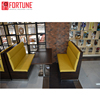Yellow chesterfield booth and table sets college project