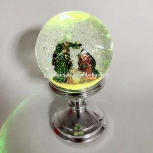 Acrylic plastic water color changing snow globe with metal silver base for jesus family