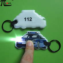 Customized police car shape PVC push flashlight keyring