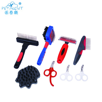 Pet grooming tangles away slicker and brush