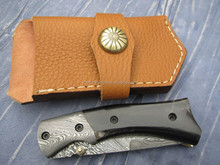 Damascus steel folding knife with horn handle