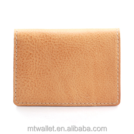 Minimalist brass snap button closure vegetable tanned leather wallet with slip pocket