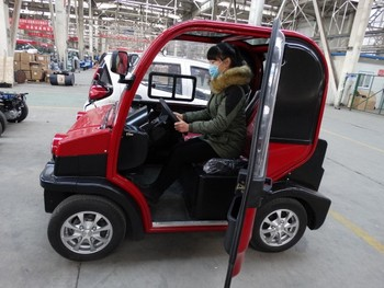 Two seater mini cars for sale electric vehicles for for Mini motor cars for sale