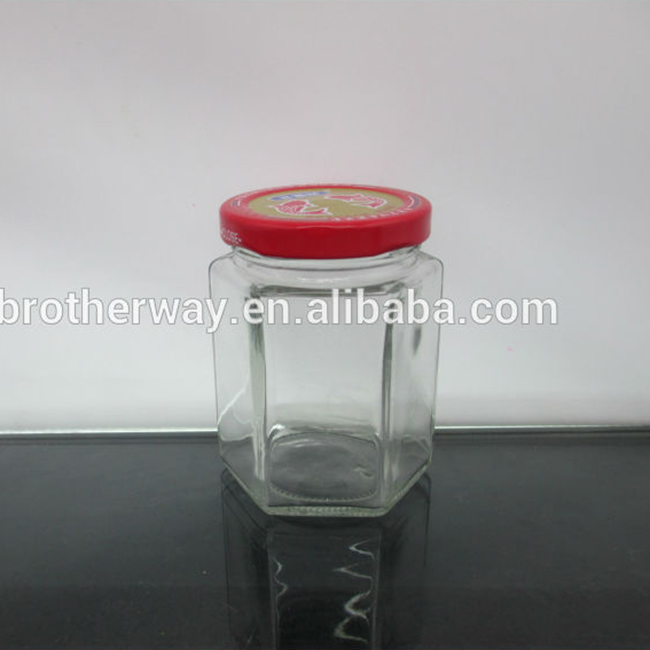 190ml clear hexagonal glass jam jar with red metal lid