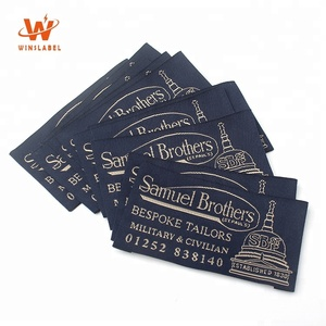 China Wholesale Custom Brand Name Logo Loop Fold Textile Clothing Woven Labels for Garment
