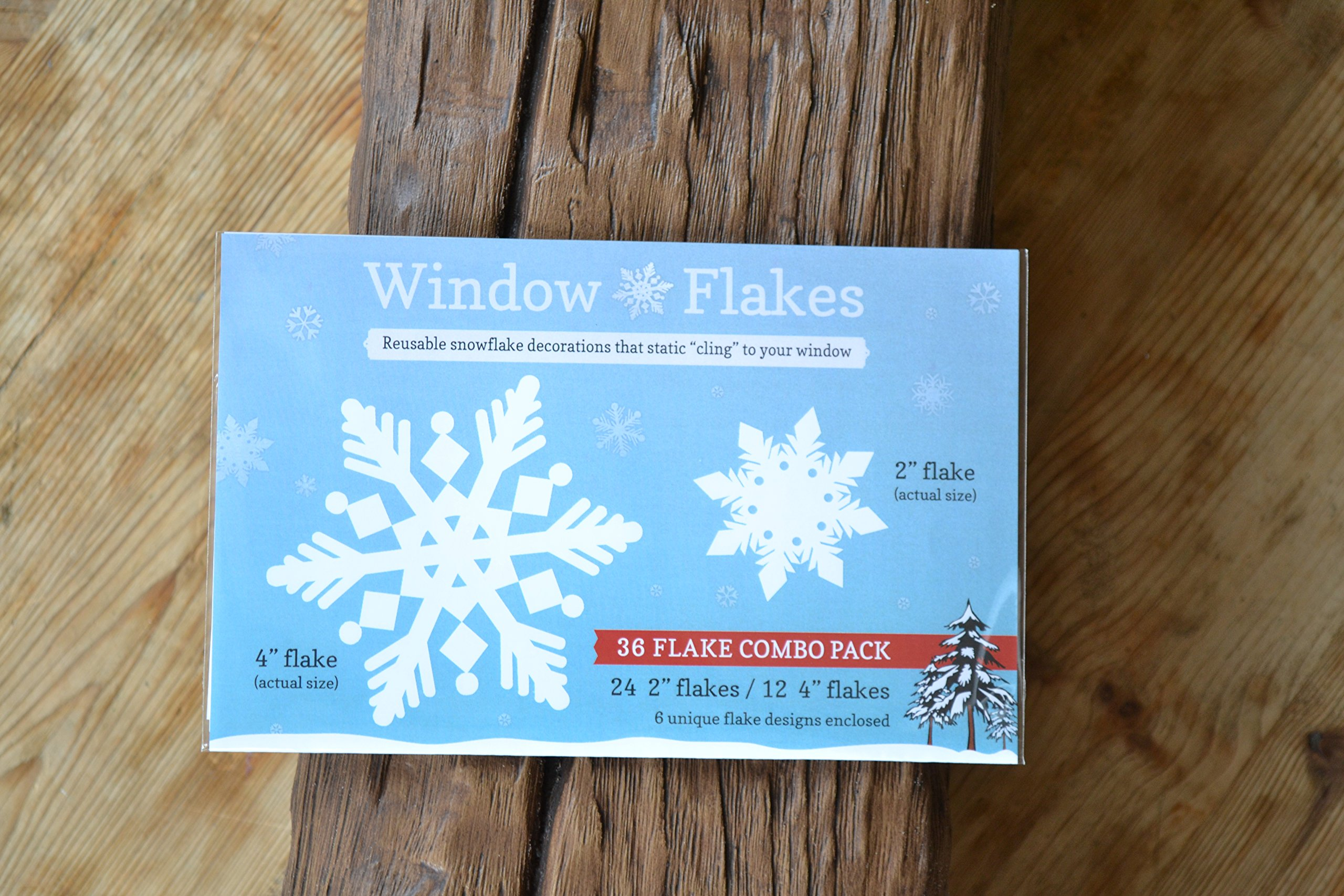"""36 Snowflake Combo Pack of white snowflake decals. This best selling snowflake cling pack contains: 12, 4"""" + 24, 2"""" snowflake decals."""