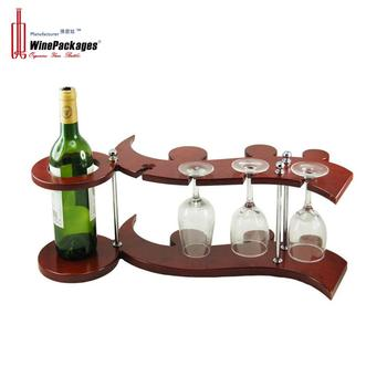A violio shaped wooden wine rack with glasses