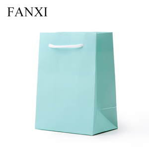 Wholesale China factory custom high end packing hand bags for jewellery and cosmetic light green leatherette paper shopping bags