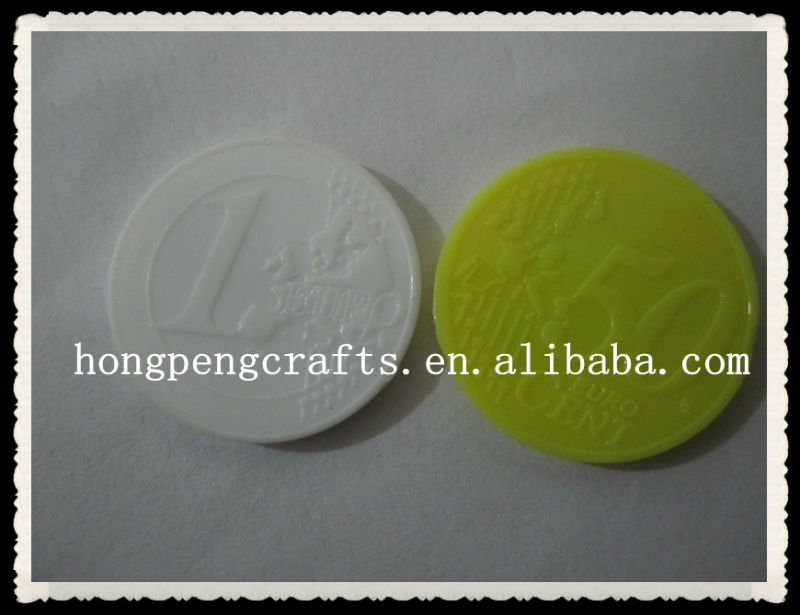 Colored embossed plastic token/coin