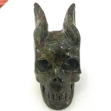 High quality dragon blood stone crystals and precious stones are engraved with winged skulls