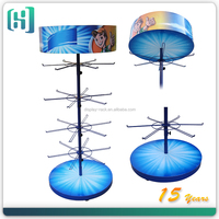 4-tier metal hanging solar power rotating display stand,Spinner Rack with pegs for tie, doll