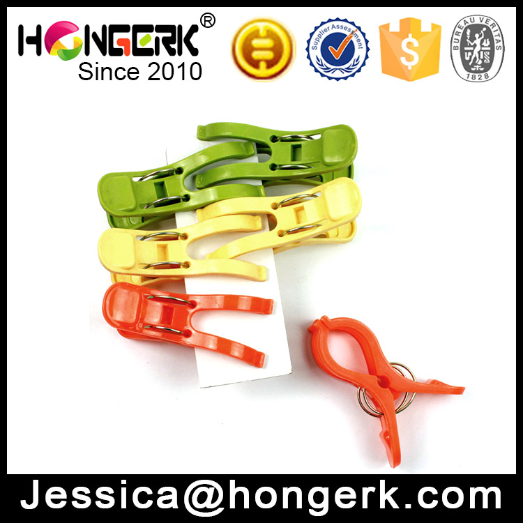 colored big plastic clothes pegs