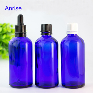 Wholesale 100ml Blue Glass Boston Round Bottle Cosmetic Use Cobalt Blue Glass Essential Oil Bottles with Dropper/Screw Cap/Spray
