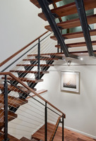 indoor stair with wood tread and railing