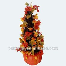 harvest decoration topiary with maple leaves and berries