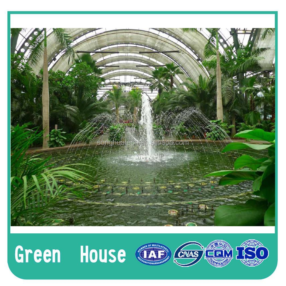 Glass greenhouse for tomato and lettuce plant in coco peat