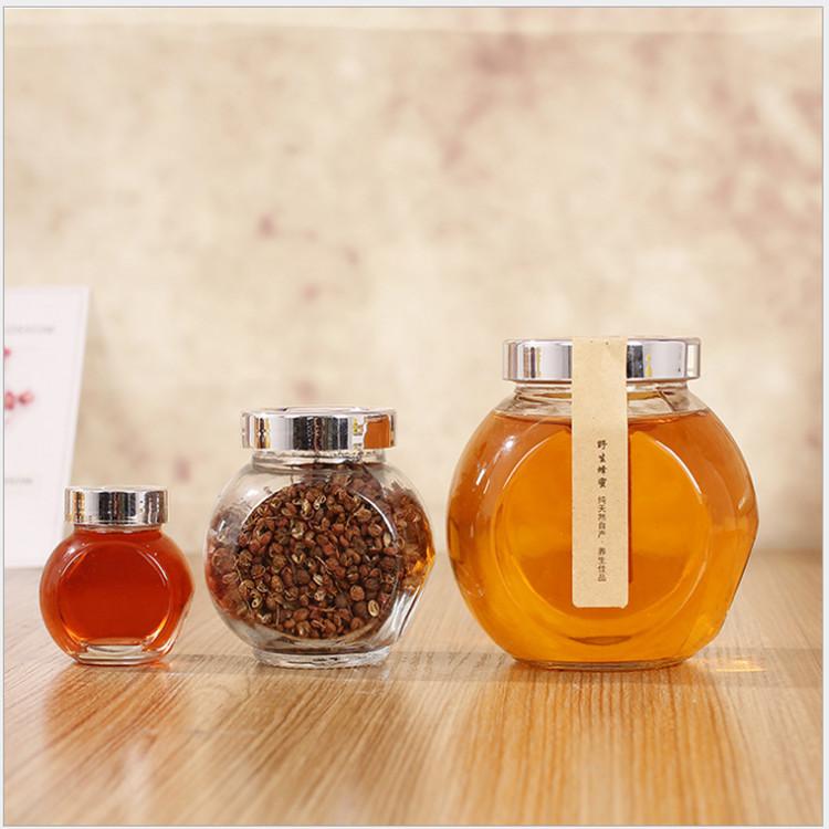 Venta al por mayor de alimentos de tambor forma de almacenamiento de vidrio tarro de especias de condimento botellas de frascos