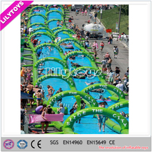 Lilytoys 0.9mm PVC tarpaulin excited Inflatable Slide The City outdoor long green giant inflatable city water slide for sale